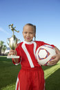 Girl With Trophy And Soccer Ball Royalty Free Stock Photo