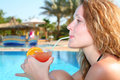 Girl with tropical juice Stock Images
