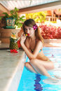 Girl in tropical pool bar Royalty Free Stock Photo
