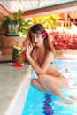 Girl in tropical pool bar Royalty Free Stock Image