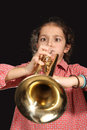 Girl with trumpet young a posing on a dark background Stock Photos
