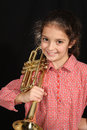 Girl with trumpet young a posing on a dark background Royalty Free Stock Photo