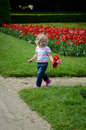 Girl with tulips blond walking in a park Royalty Free Stock Image