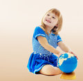 Girl turns hand globe Royalty Free Stock Photo