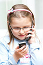 Girl with two mobile phones Royalty Free Stock Photo