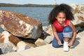Girl tying her shoe Royalty Free Stock Photo