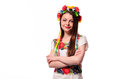 Girl in Ukrainian national traditional costume holding her flower chaplet - isolated on white Royalty Free Stock Photo