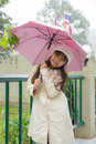 Girl and umbrella happy an in the rain Royalty Free Stock Photography