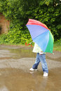 Girl with an umbrella in the rain little Royalty Free Stock Photo