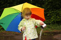 Girl with an umbrella in the rain little Royalty Free Stock Image