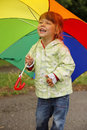 Girl with an umbrella in the rain little Royalty Free Stock Photography
