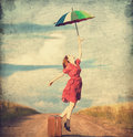 Girl with umbrella redhead and suitcase at outdoor Stock Images