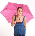 Girl with umbrella young holding a pink dotted Stock Images