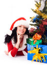 Girl under the Christmas tree with presents Stock Photography