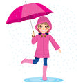 Girl under the rain cute little with pink raincoat and umbrella Royalty Free Stock Photo