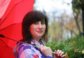 Girl under red umbrella Royalty Free Stock Photo