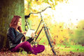 Girl under tree with bike. Royalty Free Stock Photo