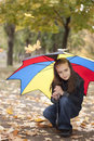 Girl under umbrella Stock Images