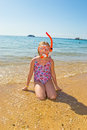 Girl in an underwater snorkel preparing to dive into the sea Royalty Free Stock Images