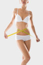 Girl underwear engaged in measurement figures young fitness Stock Image