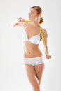 Girl underwear engaged in measurement figures young fitness Royalty Free Stock Photography