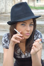 Girl with unlit cigarette Royalty Free Stock Photos