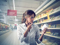 Girl unsure at supermarket Royalty Free Stock Images