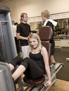 Girl using an exercise machine Royalty Free Stock Photos