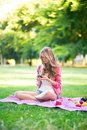 Girl using her mobile phone outdoors Royalty Free Stock Photography