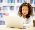 Girl using a laptop computer Royalty Free Stock Images