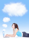 Girl using laptop connecting to cloud Royalty Free Stock Images