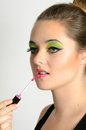 Girl using lip gloss portrait of young polish female teenage with colorful makeup on her lips Royalty Free Stock Photos