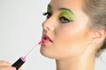 Girl using lip gloss portrait of young polish female teenage with colorful makeup on her lips Stock Photo