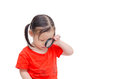 Girl using magnifying glass over white Royalty Free Stock Photo
