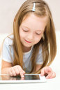 Girl using tablet computer happy little Stock Images