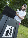 Girl using trash can young throwing in a bin Royalty Free Stock Photos