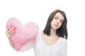Girl with valentine pink pillow heart Stock Photo