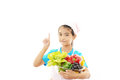 Girl with vegetables portrait of a smiling child holding isolated on white background Stock Photos