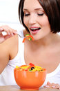 Girl the vegetarian eats vegetable food Royalty Free Stock Photography