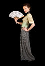 Girl in victorian dress holding a fan with her hand looking the camera on black background Stock Images