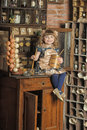 Girl in a vintage room on sideboard near historic kitchen Stock Photos