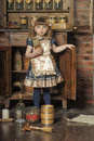 Girl in a vintage room on sideboard near historic kitchen Royalty Free Stock Photos