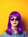 Girl with violet hair and sunglasses Royalty Free Stock Photo