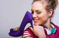 Girl with violet shoes Royalty Free Stock Image