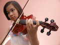 Girl and violin an asian playing Royalty Free Stock Photo