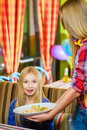 Girl visitor imagines a tasty salad or delicious Royalty Free Stock Photo