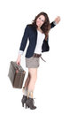 Girl with vntage suitcase waving hand Royalty Free Stock Photos