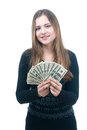 Girl with wad of money in her hands portrait happy young isolated on white Stock Photo