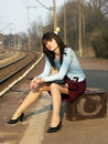 Girl waiting for the train Royalty Free Stock Photo