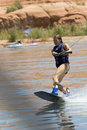 Girl Wakeboarding at Lake Powe Royalty Free Stock Images